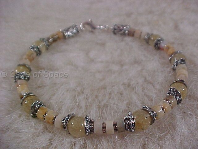 Venus Goddess Bracelet in Venus Golden Hair Quartz and Golden Jade made by an Energy Psychic.   This will MOVE ENERGY, UNBLOCK ENERGY and help the chakras to SPIN FREELY
